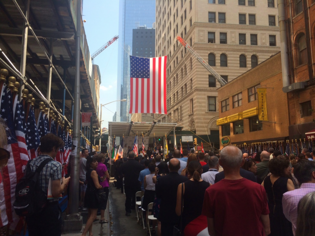 Guests and passersby pause to observe a moment of silence for those who were lost on September 11, 2001. Image by Elizabeth McCauley.
