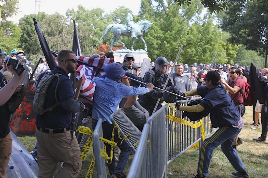 "White nationalists and counter protesters clash in front of the Robert E. Lee statue in Charlottesville, Va.'s Emancipation Park ahead of the ""Unite the Right"" rally. Photo: Sanjay Suchak"